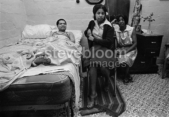 Recovering stroke victim, with his wife and daughter, Manenberg, near Cape Town, 1976, South Africa