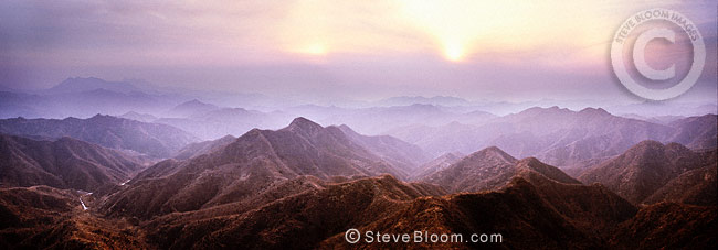 Sunset in mountians through which the Great Wall of China runs, near Beijing, China