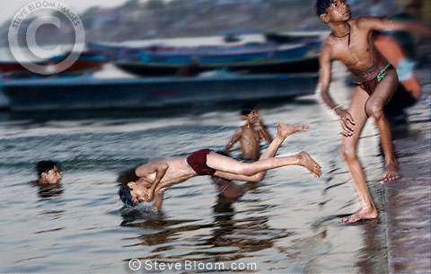 Boys swimming in the Ganges, Varanasi, India