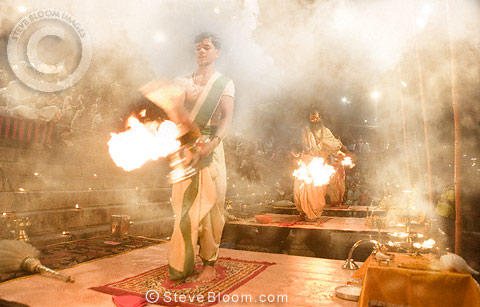 Hindu holy men performing religious ceremony (puja), Varanasi, India