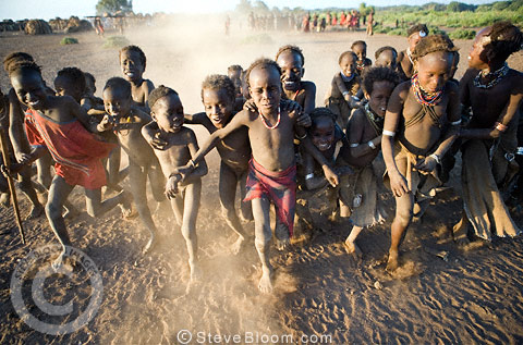 Dassenech children at playing in the late afternoon light. Omo Delta, Ethiopia, Africa.
