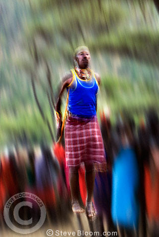 Samburu tribesman dancing to celebrate the mass circumcision of the young men of the tribe. Mount Nyiru, Kenya, Africa