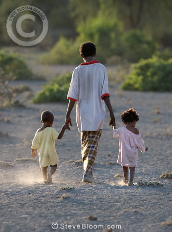 Boy walking with small children, Afar tribe, Bilen, Ethiopia