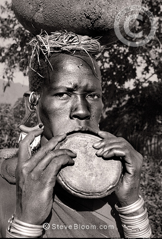 Suri tribeswoman with clay lip plate, Omo Delta, Ethiopia