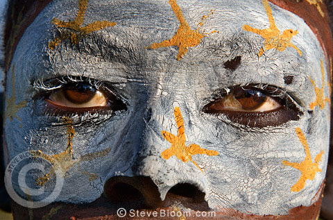 Suri woman with painted face, Omo Delta, Ethiopia.