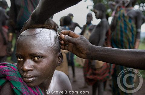 Head shaved Having