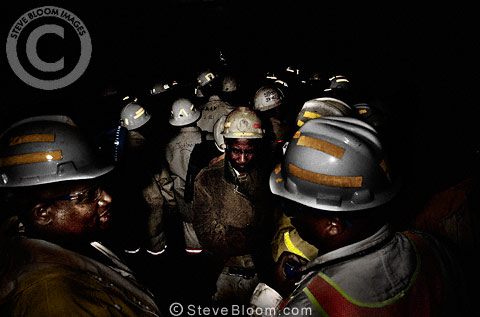 Gold miners in cage lift plunging 3km to work underground, near Johannesburg, South Africa