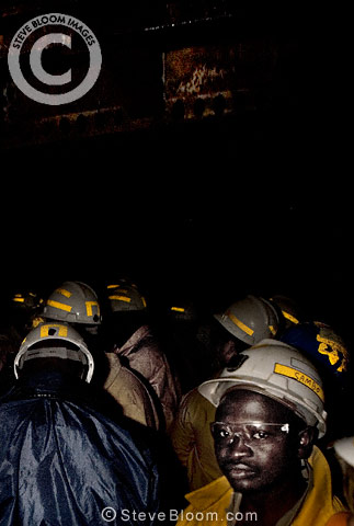 Gold miners in cage lift going to work underground, near Johannesburg, South Africa