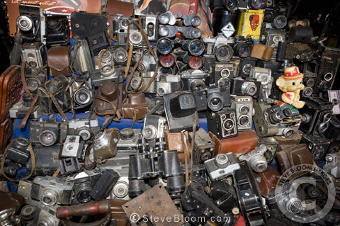 Old, second-hand cameras and binoculars for sale in the Djemaa el Fna souq, Marrakech, Morocco