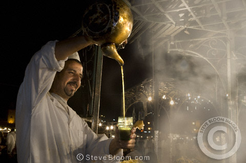 Stall vendor pouring tea in the Djemaa el Fna souq in Marrakech, Morocco