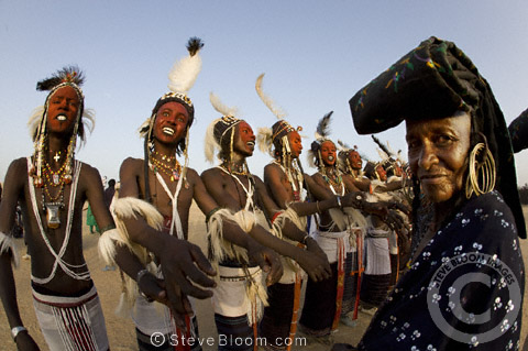 Wodaabe men performing for the tribeswomen under the direction of a female tribe elder during the Gerewol Festival, north of Abalak, Niger