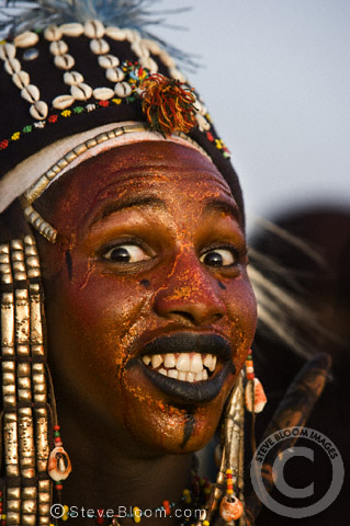 Wodaabe man performing for the tribeswomen during the Gerewol Festival, north of Abalak, Niger