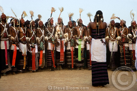 Young Wodaabe woman choosing a partner from the performing men during the Gerewol Festival, north of Abalak, Niger