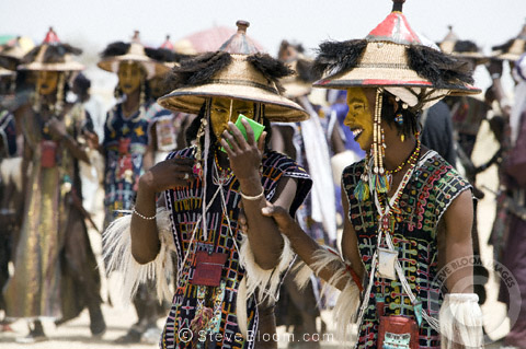 Wodaabe men looking in the mirror before performing for the tribeswomen during the Gerewol Festival, north of Abalak, Niger