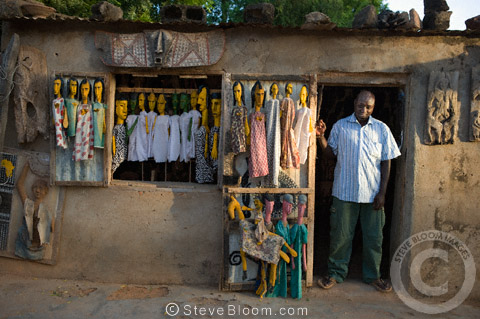 Man in the doorway to his shop in Sergou, Mali