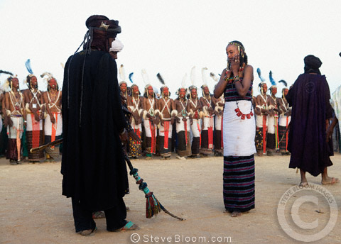 A Wodaabe girl chooses a partner from the dancing men at the Gerewol Festival, north of Abalak, Niger