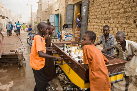 Boys playing table football in the streets of Mopti, Mali