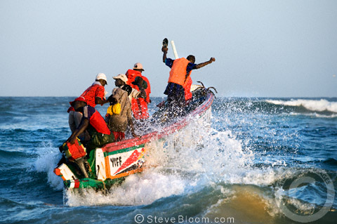 Fishermen setting off in a boat, St. Louis, Senegal, west Africa