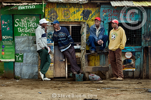 Men chatting outside shops, Nairobi, Kenya.