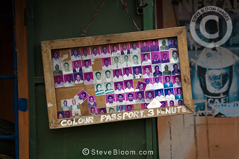 Passport photos display in a photo studio, Nairobi, Kenya.