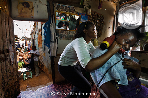 Monicah Kimani and customer, Beauty Hair Salon, Langata, Nairobi, Kenya.