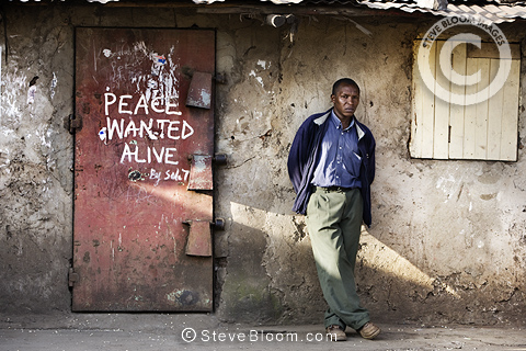 Shop door with slogan 'Peace wanted alive', Nairobi, Kenya.