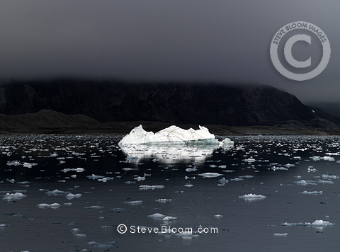 Polar sea with lone iceberg, Liefdefjorden, Svalbard, Norway