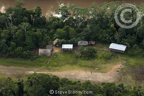 Huaorani Houses seen from the air; simple structures built directly on the ground with a frame made from thin branches covered with palm leaves. Bameno Community, Yasuni National Park, Amazon rainforest, Ecuador, South America.