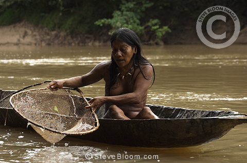 Huaorani indian woman fishing with home made net made from for Amazon fishing net