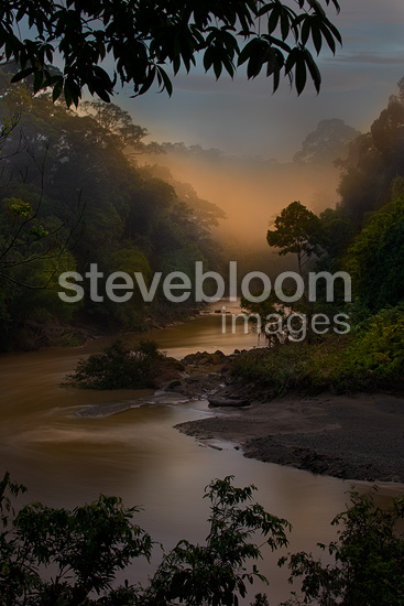 Dawn/sunrise over the Segama River, with mist hanging over lowland Dipterocarp rainforest. Heart of Danum Valley, Sabah, Borneo