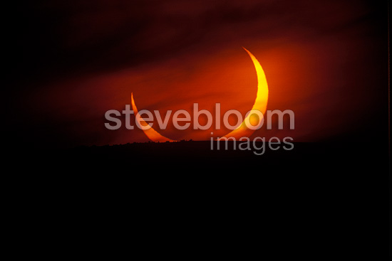 Sun crescent setting at the end of an annular eclipse, Morocco