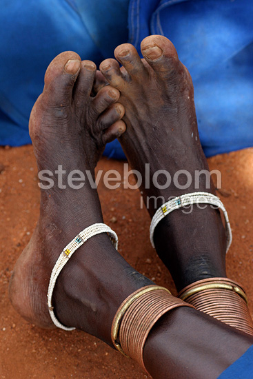 Bracelets at a Ndorobo woman's ankles Tanzania