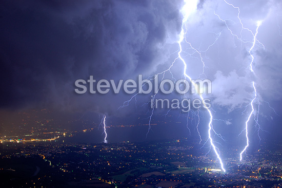 Triple lightning strike during a violent storm over the city of Genève, France