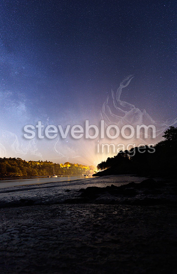 Harbour Lights of Kerdruc along the river Aven, Pont-Aven. The powerful lights filter through the trunks of wood and draw lines of light in the constellation Scorpius. To the left, Sagittarius rising. Quarter Moonrising.