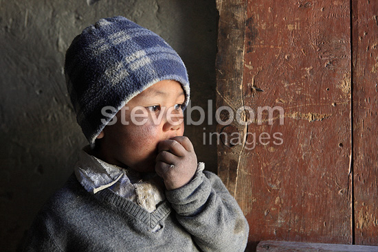 Portrait of a child in a village in India, Pidmo