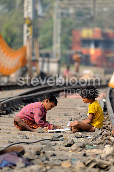 Children playing on the tracks of Calcutta, India