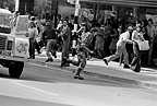 Policeman chasing man, Cape Town, 1976, South Africa