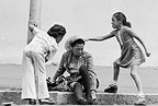 Children taunting drunk homeless woman ('Bergie'), Woodstock, Cape Town, 1975, South Africa