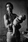 Man at home with daughter, Manenberg, Cape, 1977, South Africa