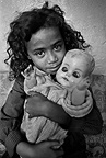 Young girl with doll, Manenberg, 1976, South Africa