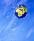 Map of earth on a balloon floating away (illustration)