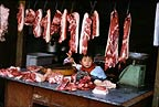 Market stall selling meat, Chengdu, Sichuan province, China