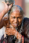 Hindu woman pouring water over her head in the Ganges, Varanasi, India