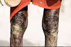 Close-up of knees of Karo tribesman, Omo Delta, Ethiopia, Africa