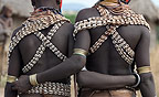 Young Karo girls with their arms around each other in friendship, Omo Delta, Ethiopia, Africa