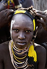 Karo girl having her hair decorated by other girls, Omo Delta, Ethiopia, Africa