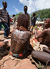 Hamar woman at market.  Her scars result from ritual whipping which she undergoes to prove her devotion. Omo Delta, Ethiopia, Africa