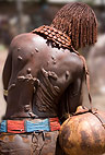 Hamar woman displaying scars resulting from ritual whipping which she undergoes to prove her devotion. Omo Delta, Ethiopia, Africa