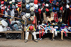 Market stall selling hats, with stall holder sleeping, head on arms, Nairobi, Kenya, Africa.