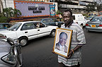 Vendor selling framed portrait of President Mwai Kibaki of Kenya, in the streets of Nairobi.
